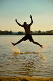 Young man jumping for fun on the beach Stock Photography