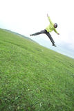 Young man jumping on the grass Royalty Free Stock Image
