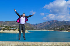 Young man jumping of joy. On the bridge Stock Images