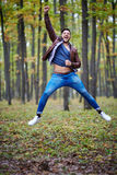 Young man jumping for joy Royalty Free Stock Photos