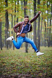 Young man jumping for joy Stock Photo