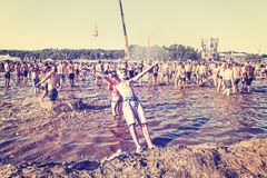 Young man jumping into mud. Royalty Free Stock Images