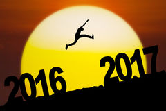 Young man jumping with number 2016 and 2017 Royalty Free Stock Image