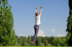 Young man jumping outside Stock Images