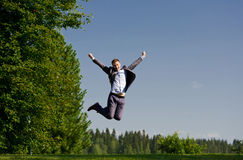 Young man jumping outside Stock Photos