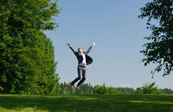 Young man jumping outside Stock Photo
