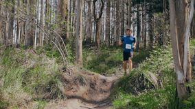 Man jumping participating in trail race stock video