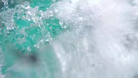 Young man jumping in the pool and splashing water with droplets, slow motion. 1920x1080. Young man jumping in the pool, slow motion. 1920x1080, hd stock video footage