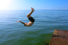 Young Man Jumping in The Sea Royalty Free Stock Images