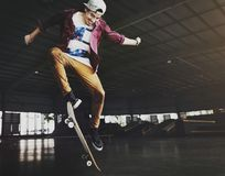 Young man jumping on skateboard stock photography