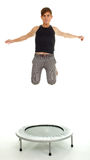 Young man jumping on trampoline Royalty Free Stock Photography