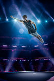 Young man is jumping on trampoline Royalty Free Stock Images