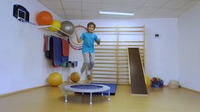 The young man jumping on a trampoline stock video footage
