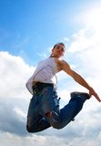 Young man jumping up Stock Photography