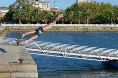 Young man jumping into water Royalty Free Stock Photos