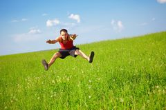 Young man jumps Stock Photos