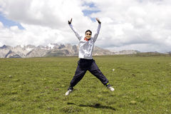 Young man jumps high Stock Images
