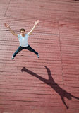The young man jumps with joy Stock Image