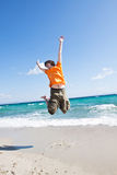 The young man jumps at the sea Stock Photography