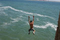 THE YOUNG MAN JUMPS IN WATER Royalty Free Stock Photo