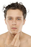 Young man just coming out of shower Stock Images