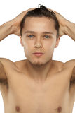 Young man just coming out of shower Stock Photography