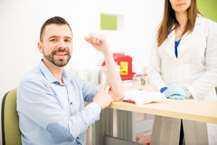 Young man just took a blood test royalty free stock photos