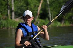Young Man Kayaking Stock Photography