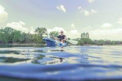 Young Man Kayaking on Lake. Lake Kayaking. Outdoor Sport royalty free stock images