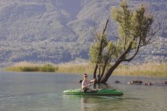 Young man kayaking on the lake royalty free stock photography