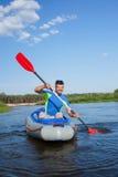 Young man kayaking Stock Photography