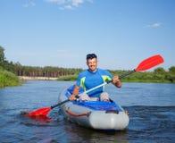 Young man kayaking Stock Images