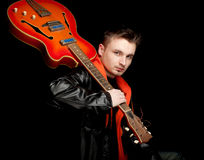 Young man keeping orange electric guitar Royalty Free Stock Photo