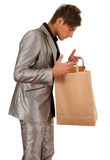 Young man keeping paper bag Royalty Free Stock Image