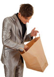 Young man keeping paper bag Royalty Free Stock Photos