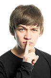 Young man with keeping silence sign Royalty Free Stock Photography