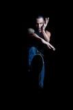 Young man kick shadow Royalty Free Stock Image
