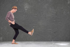 Young man kicking and smiling Royalty Free Stock Image