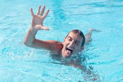 Young man kidding in pool. Young man kidding in blue pool Stock Photos