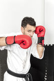 Young man in kimono throwing punches Stock Photo