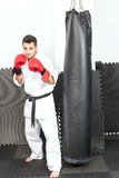 Young man in kimono throwing punches Stock Photography