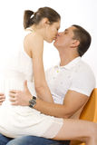 Young man kiss girl on chair Royalty Free Stock Image