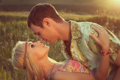 Young man kisses beautiful woman Stock Photo
