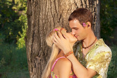 Young Man Kisses Fine Young Woman Stock Images