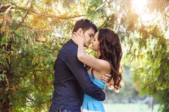 Young man kisses his beautiful girlfriend Royalty Free Stock Images