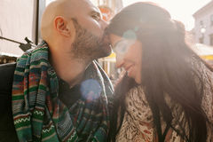 Young man kisses his girlfriend in the city Stock Photos