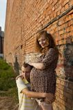 Young man kisses his pregnant wife Royalty Free Stock Images