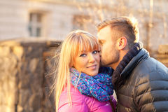 Young man kissing a beautiful woman Royalty Free Stock Photo