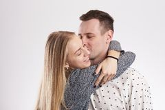 Young man kissing blonde woman Stock Photos