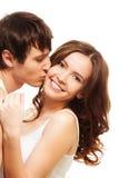 Young man kissing girl Stock Image
